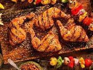 Рецепта Печени пилешки бутчета на скара, мариновани с мед, чесън, сос Уорчестър и сок нар